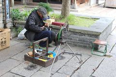 Shoemaker repairs shoes in the water town Wuzhen, China Stock Images