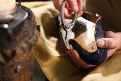 Shoemaker sews shoes Stock Photos