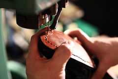 Shoemaker, shoemaking machine Stock Photography