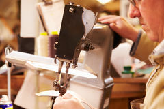 Shoemaker stitching leather in a workshop, close up Royalty Free Stock Photo