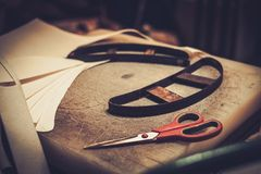 Shoemaker studio craft working table with professional tools. Royalty Free Stock Photo