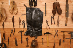 Vintage Shoemaker Tools. Shoemaker Tools hanging in a wooden wall stock photos