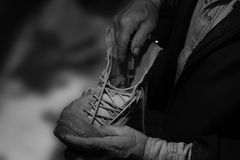 SHOEMAKER. A shoemaker working on a shoe Royalty Free Stock Image