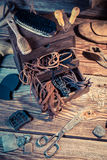 Shoemaker workplace with tools, leather and shoes Stock Images