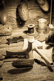 Shoemaker workplace with tools, shoes and laces Stock Photography