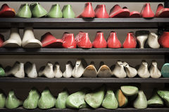 Shoemaker workshop. Closeup of the shoes on the sleves in the shoemaker workshop Royalty Free Stock Image