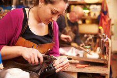 Shoemakers working in a workshop Royalty Free Stock Photography