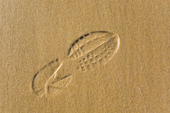 Shoeprint on sand Royalty Free Stock Images