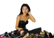 Shoes. Young, beautiful woman sitting with her shoes, isolated on white Royalty Free Stock Photo