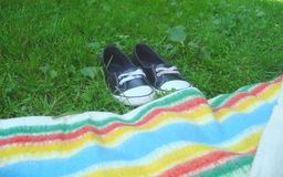 Shoes. Black shoes in grass near colours Royalty Free Stock Photo