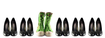 Shoes. Black classic shoes and green boots on the white background stock photos