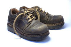 Shoes. Two children's old shoes with shoelaces Stock Photography