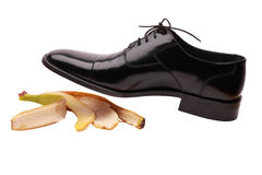 Shoes. Banana peel under the black shoe Royalty Free Stock Photography