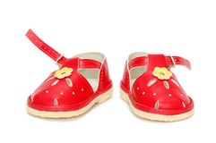 Shoes. Red children shoes over white background stock photography