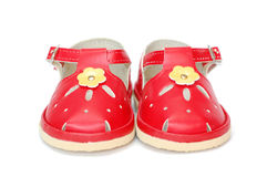 Shoes. Red children shoes over white background royalty free stock photography