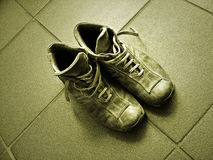 Shoes. A pair of used shoes on the floor royalty free stock images