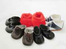 Shoes. Several pairs of doll shoes and a pair of slippers stock images