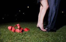 Shoes. A couple kissing at night Royalty Free Stock Photography