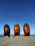 Shoes. On beach in sand with sea background stock photo