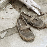 Shoes. Old shoes on stone tiles Stock Photo