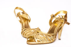 Shoes. Woman golden shoes  on white, selective focus Stock Photos
