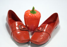 Shoes. Ladies' shoes and pepper on white background royalty free stock image