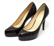 Shoes. Two black glossy ladies fashoin shoes on a high heels Stock Photo
