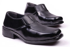 Shoes. Black men shoes in isolated background Royalty Free Stock Image