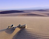 Shoes. Left alone in the desert sand Royalty Free Stock Image