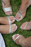 Shoes. A bride and her bridesmaids silver shoes Royalty Free Stock Photos
