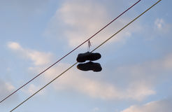 Shoes. Hanging on wires Stock Image