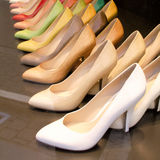 Shoes addiction. Shoes from different colours aligned Royalty Free Stock Image