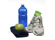 Shoes, apple, towel and water Royalty Free Stock Photo