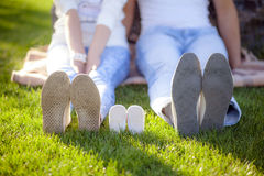Shoes for babies. And parents Stock Photography