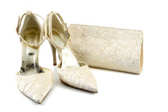 Shoes and bag. Shoes and handbag on white background Royalty Free Stock Photos