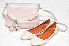 Shoes and bag Stock Photos