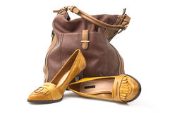 Shoes and bag. Leather footwear female brown and bag Stock Photos