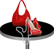 Shoes and bag on the table Stock Photo
