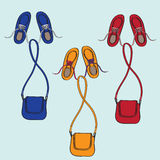 Shoes and bags flying through the sky. Design illustration of three colourful trendy sets of casual shoes and bags flying on a blue background Royalty Free Stock Images