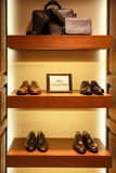 Shoes and bags in man clothing shop Royalty Free Stock Image
