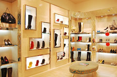 Shoes and bags in store. With modern decoration