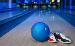 Shoes and balls for bowling game Royalty Free Stock Images