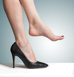 Shoes and bare feet. Wearing high heeled shoes and bare feet Royalty Free Stock Photo