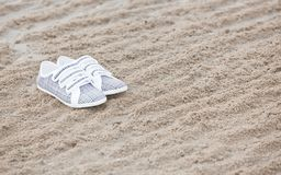Shoes on a beach Royalty Free Stock Photography