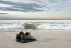Shoes on beach Royalty Free Stock Photo