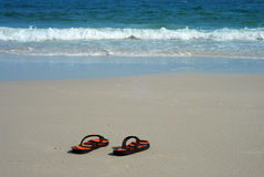 Shoes on the beach. Shoes beach sea sand background thailand foot design relax stock image
