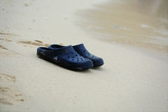 Shoes on beach. Shoes sand Pairs Peaceful background Stock Photography