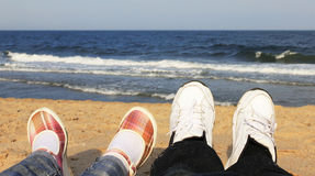 Shoes on the beach Stock Photography