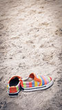 Shoes on beach Royalty Free Stock Images
