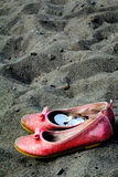 Shoes on the beach Royalty Free Stock Images